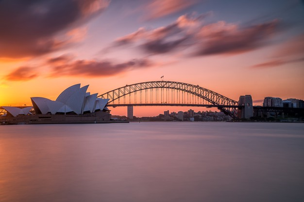 beautiful-shot-sydney-harbor-bridge-with-light-pink-blue-sky_181624-16041
